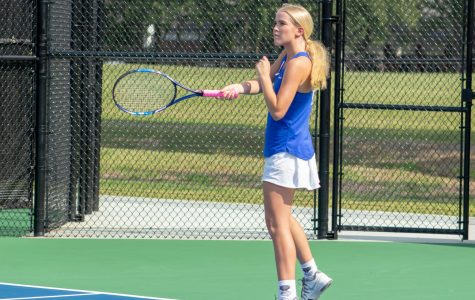 Senior Kate Ferguson returns the ball in a match against Fayetteville early in the season.  The Wampus Cat Tennis team was successful in their conference matches this month.