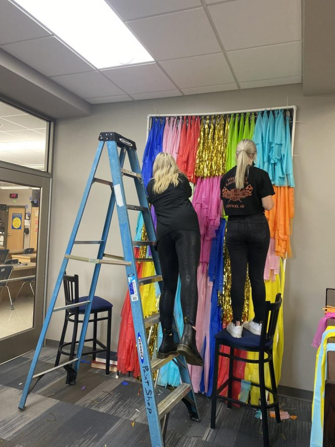 Student council members work on Homecoming decorations in the library the week of September 20.