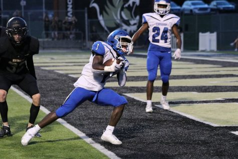 """Manny Smith, 12 scores a touchdown for Conway. The Wampus Cats beat the Bentonville Tigers 55-41 the night of that game. """"I scored 2 touchdowns and ran for about 110 yards. It was exciting to beat Bentonville because we haven't beat them in 5 years. My goals for this year are to win state and bond better with my team,"""" Smith said."""