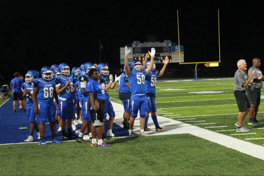 9th Grade White celebrates a touchdown in their second victory of the season.