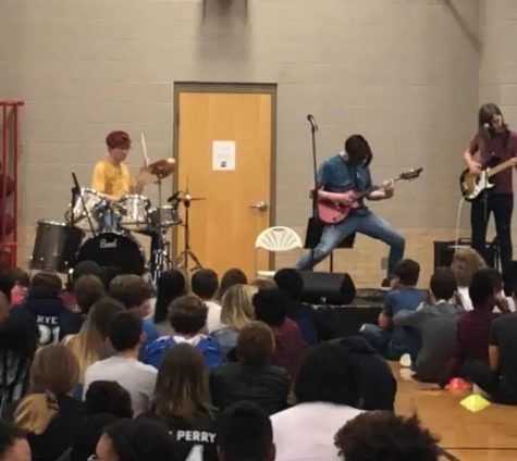 """Limited Time Rock Group """"Rainbow Prism Complex"""" plays at the Junior High School Talent Show in Spring 2019. (members from the left are Ben Drinkwater, William Polk, and Avery Steadham)"""