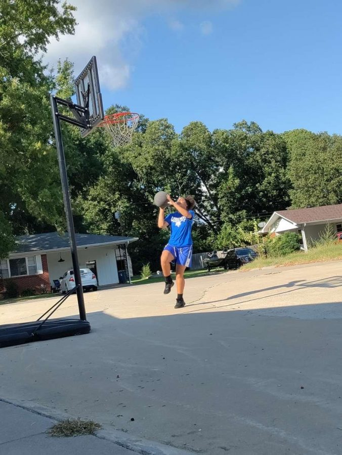 8th grader Kaia Stewart practices basketball at home.  She is looking forward to the upcoming season.