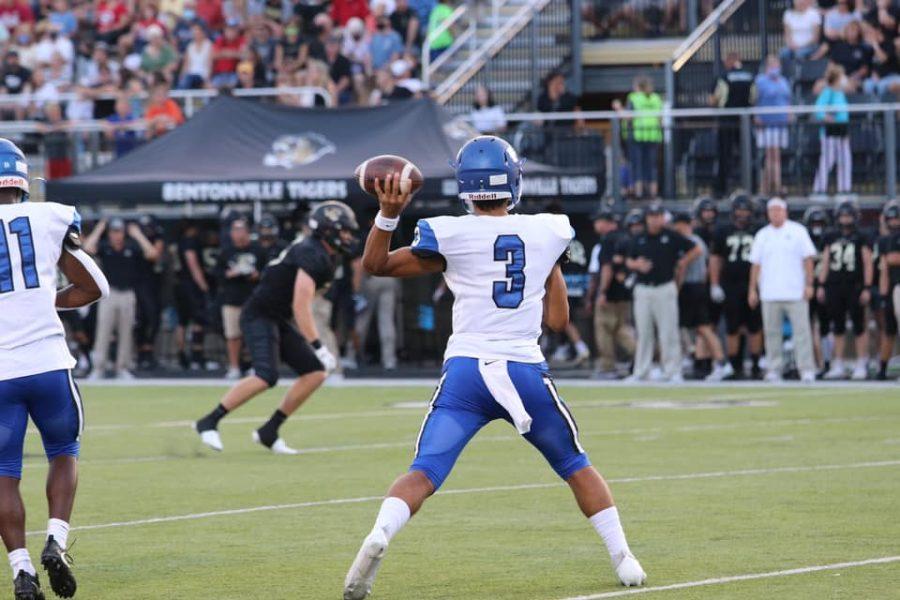 Sophomore QB Donovan Omolo passes the ball in Bentonville September 3.